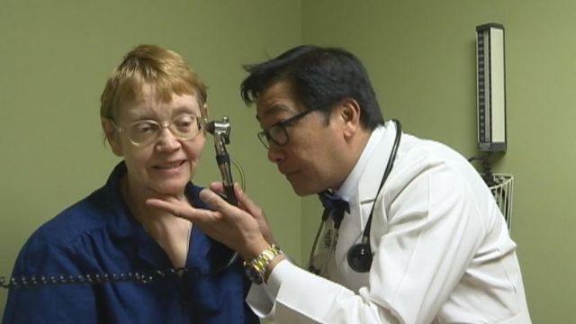 Dr. Emmanuel Sarmiento treats allergy patient. (FOX Carolina/ March 7, 2016)