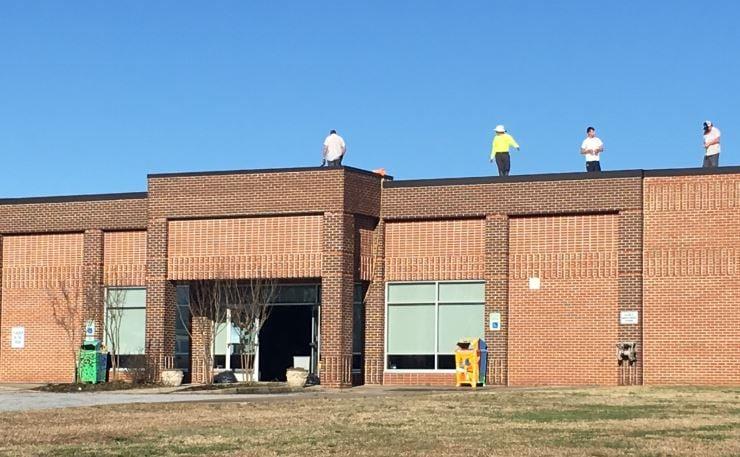 Crews repairing the roof Tuesday (FOX Carolina/ March 15, 2016)