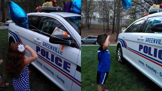 Amira, 4, and Richie, 3, salute Officer Jacobs at the memorial. (Courtesy: Erica J.)