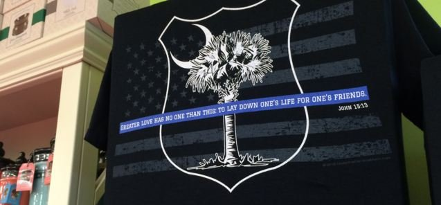 Shirt made in honor of Officer Allen Jacobs. (Source:Fox Carolina)