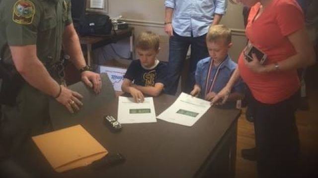 Officers dnr purchase hunting fishing licenses for sons for Sc dnr fishing license
