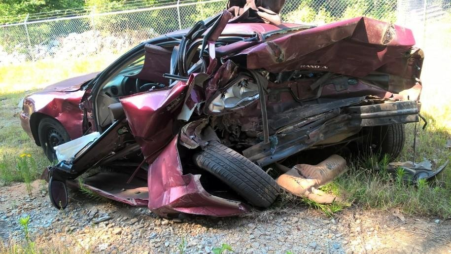 The mangled wreckage of Joyce Fife's car, struck by a distracted driver in GA (FOX Carolina)