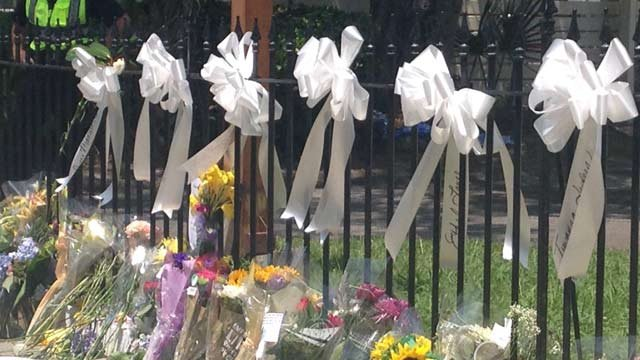 Flowers hang outside Emanuel AME Church days after mass shooting on June 17, 2015 (FOX Carolina)