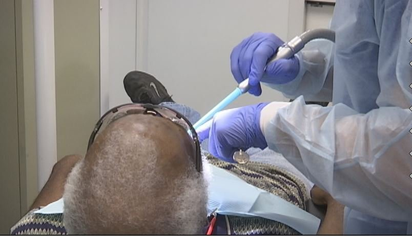 Andrew, a patient, receives free treatment inside the dental truck (FOX Carolina)