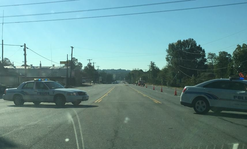 Police cars block N. Pleasantburg Dr.