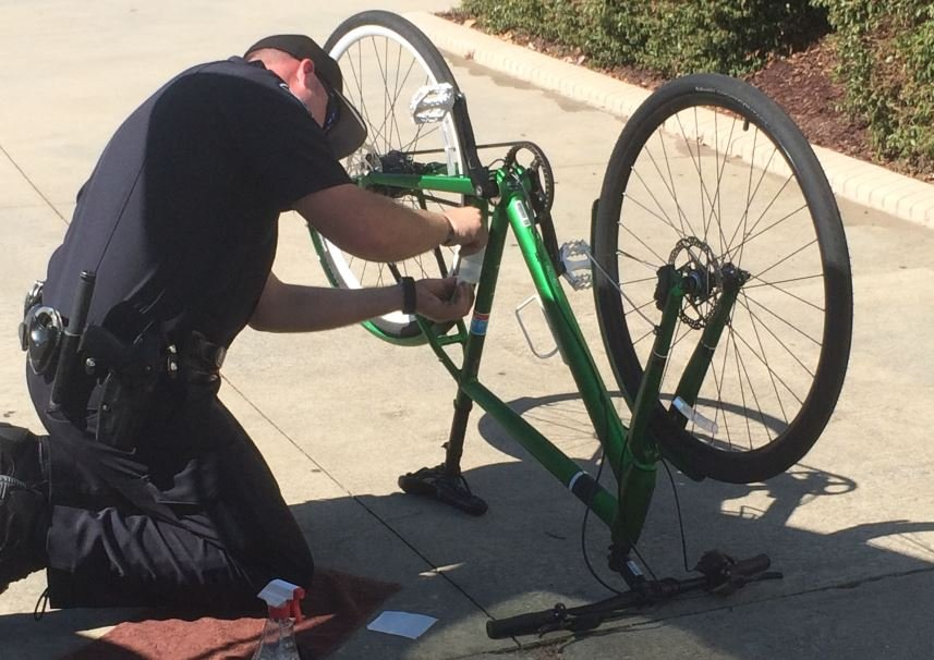 GPD officers register bikes at Bon Secours Wellness Arena (FOX Carolina/ Sep. 24, 2016)