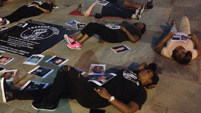 "Demonstrators gathered downtown Greenville at a ""Die In"" protesting violence. (FOX Carolina/ 9/24/16)"