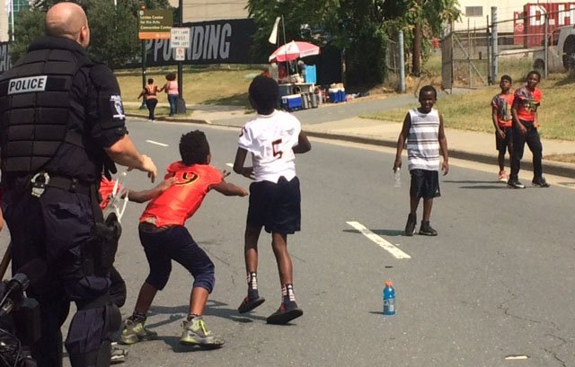 CMPD officer plays football with kids in Charlotte. (Sep. 25, 2016/FOX Carolina)