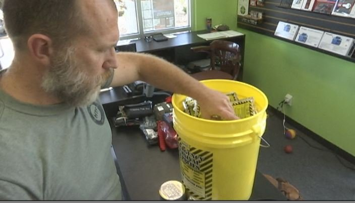 Steve Butler digs through a lockdown kit at HTF Survival Store (FOX Carolina)