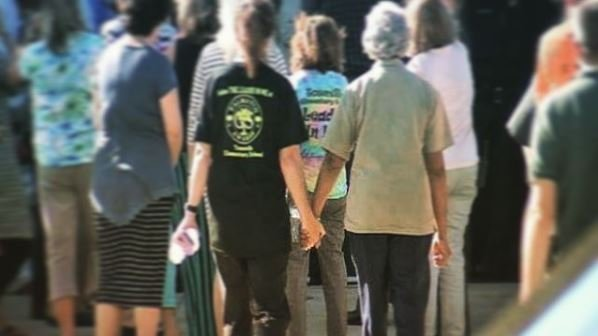 Parents hold hands while picking up Townville Elementary students. (Sep. 28, 2016/FOX Carolina)