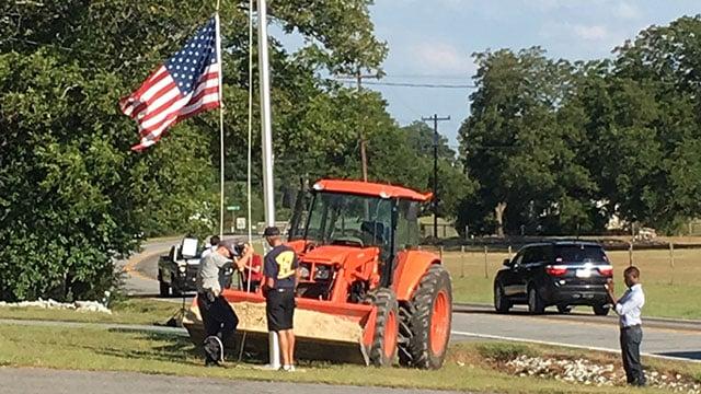Firefighters raise flag pole at Townville FD. (Sep. 29, 2016/FOX Carolina)