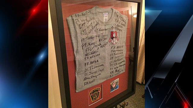 Shaver's fellow Lake Cunningham firefighters signed a shirt that was displayed at his visitation Friday night. (FOX Carolina/10/6/16)