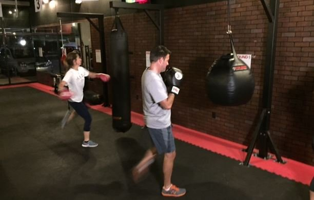 People work out inside a Greenville 9Round gym (FOX Carolina)