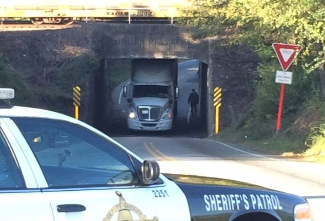 The truck stuck under the railroad bridge (FOX Carolina/ Oct. 17, 2016)