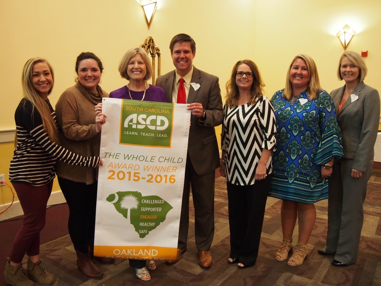 """Dr. Josh Patterson and staff at Oakland Elementary receiving the """"Whole Child Award"""" (Courtesy: Spartanburg District Two)"""
