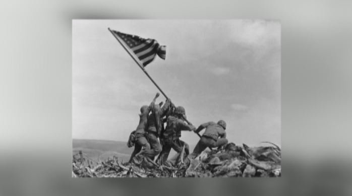 Upstate veteran Stanley Moore was standing by as Marines raised the American flag at Iwo Jima and this iconic portrait was taken (FOX Carolina)
