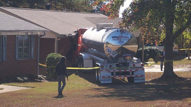 Scene after semi tractor-trailer smashed into Spartanburg home. (Source: iWitness)