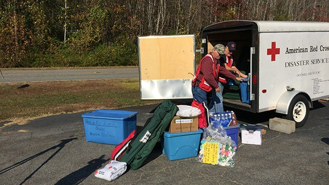 Volunteers gather supplies at Midway Baptist Church in Pickens, where Pickens Co. evacuees are welcome to shelter in place during the wildfires. (FOX Carolina/ 11/12/16)