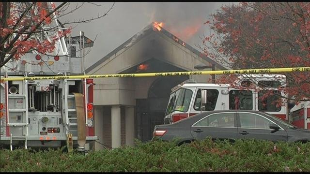 Flames shoot from the roof of Holmesview Vocational Rehab Center (FOX Carolina/ Nov. 13, 2016)