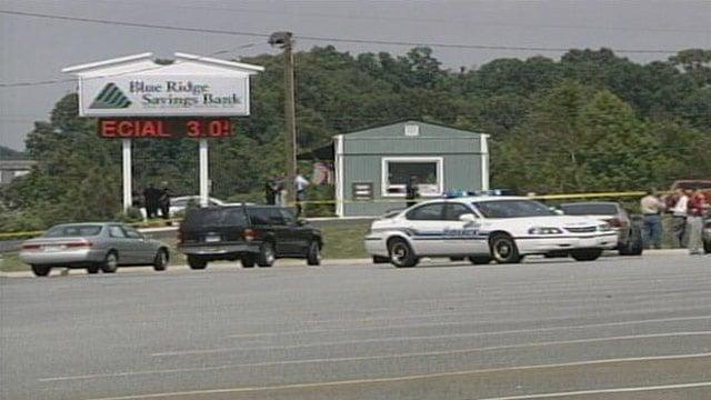 Crime scene tape surrounds Blue Ridge Savings bank in Greer after a triple homicide. (May 16, 2003/FOX Carolina)