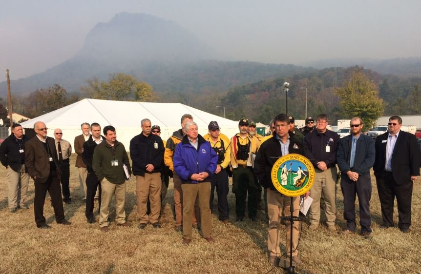 McCrory (at podium) gives an update on the WNC fires (FOX Carolina/ Nov. 14, 2016)