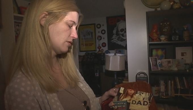 Sarah Backlund looks at a picture of her daughter Maddie, who until now, did not know the fate of her father, Johnny Coxie (FOX Carolina)