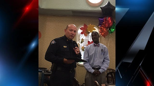 Greenville Police Chief Ken Miller accepts an award at Put Down The Guns Now Young People Organization's annual banquet. (FOX Carolina/ November 17, 2016)