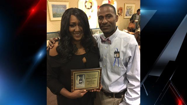 The family of a victim of gun violence accepts an award at Put Down The Guns Now Young People Organization's annual banquet. (FOX Carolina/ November 17, 2016)