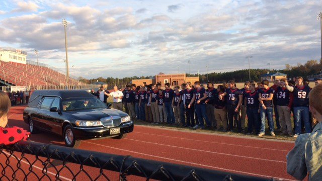 The Belton-Honea Path high school football team stood by as a hearse carrying Gambrell rode by to the funeral. (FOX Carolina /11/23/16)
