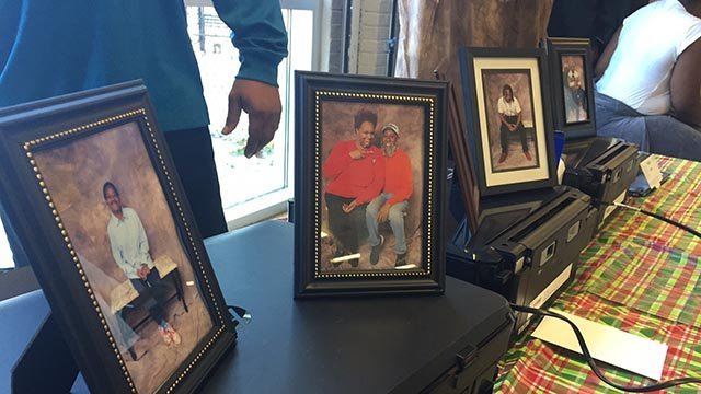 Jeremiah Drummond takes photos of families at a soup kitchen in Spartanburg (November 24, 2016 FOX Carolina)