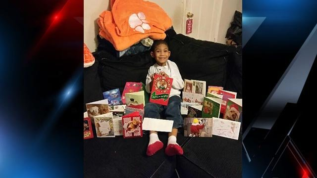 Brayden with cards he received from the community. (Dec. 3, 2016/FOX Carolina)