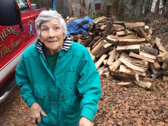 Wilma Jones, 84, smiles in front of huge pile of donated firewood. Now, she can stay warm through the winter (FOX Carolina)