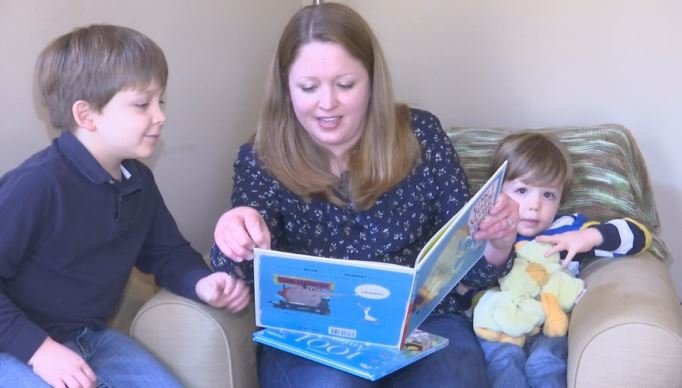 Teresa Hoover reads with her sons. Hoover started a crowdfunding campaign to purchase books Greenville police can donate to children (FOX Carolina)