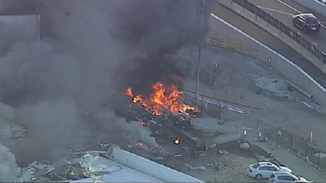 (Channel 9 via AP). This image made from video shows the site of a plane crash at Essendon Airport in Melbourne, Australia Tuesday, Feb. 21, 2017. An official says a light plane has crashed into a shopping mall in the city of Melbourne.