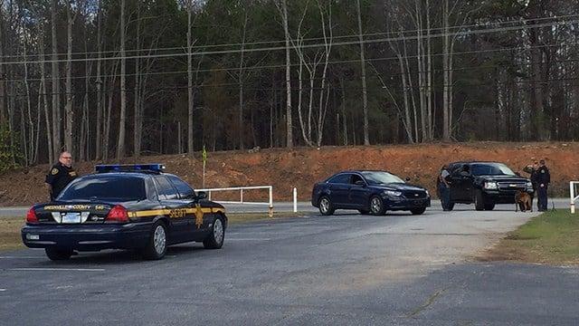 Manhunt underway at Ware Place Church of God parking lot. (FOX Carolina/2/24/17)
