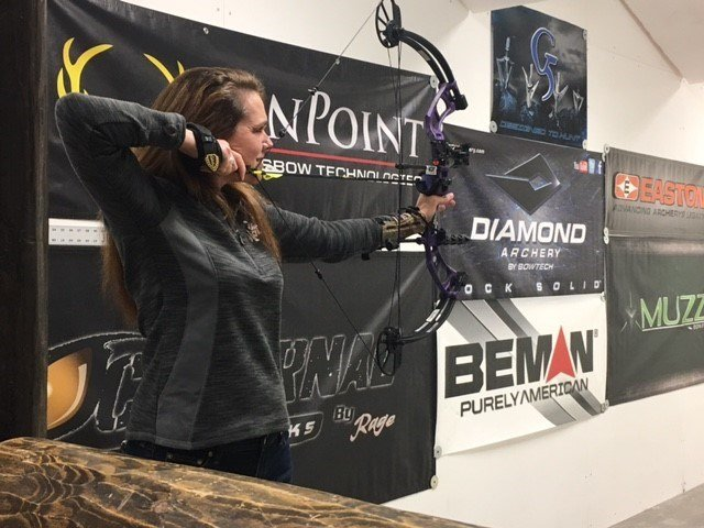 President of 'Shoot Like A Girl' Karen Butler shows off shooting skills using a compound bow (FOX Carolina: 2/25/2017).
