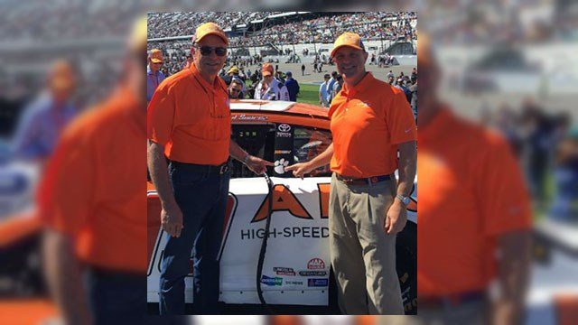 Bob Stanzione (left), Clemson President Jim Clements (right) standing with Joe Gibbs racing #19 car in honor of Clemson. (Source: Twitter)