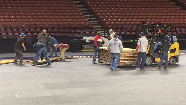 Court floor being laid at Bon Secours Wellness Arena. (Feb 26, 2017 FOX Carolina)