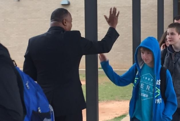Community members greet students at Laurens High (FOX Carolina/ March 6, 2017)