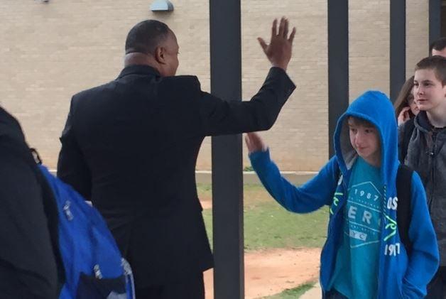 Community members greet students at Laurens High (FOX Carolina/ March 6, 2017)