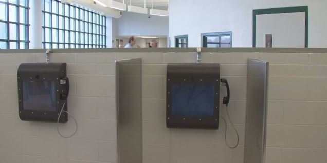 Renovated jail lobby features visitation video chat monitors connected to telephones. (FOX Carolina)