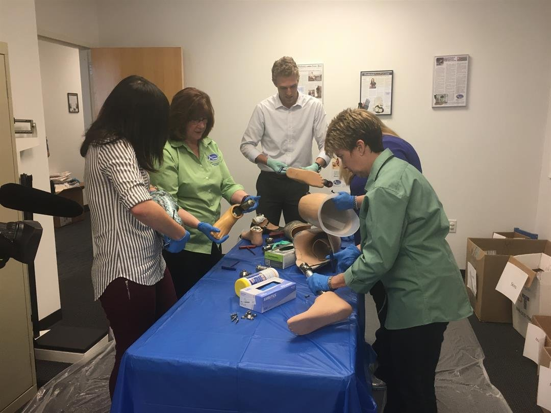 Volunteers go through donated prosthetics