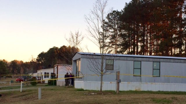 Deputies investigating at scene where woman found shot to death in Clinton home. (FOX Carolina/ 3/10/17)