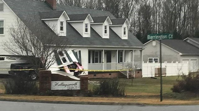 Car crashes into homeowner's truck, sending it crashing into Easley home (Source: iWitness)