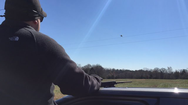 Deputies are searching by land and by air for a suspect (March 17, 2017/ FOX Carolina)