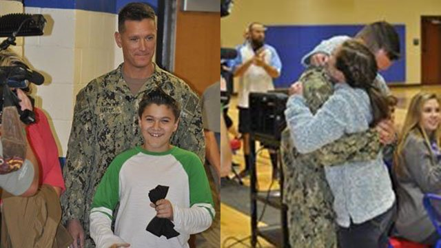 Commander Travis Hayes and son Cam Hayes (left), Commander Travis Hayes embraces daughter Abby Hayes (right). (Source: School District of Pickens County Facebook)