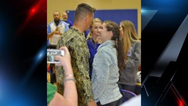 Commander Travis Hayes and daughter Abby Hayes exchange warm smiles at their sweet reunion (Source: School District of Pickens County Facebook)