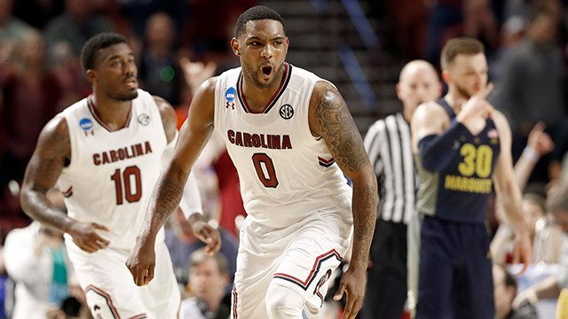 South Carolina's Sindarius Thornwell (0) reacts to making a basket against Marquette during the second half in a first-round game of the NCAA. (Source: AP Images)