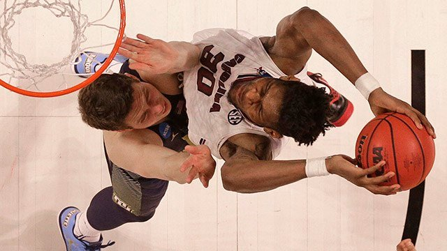 South Carolina's Chris Silva, right, goes up against Marquette's Matt Heldt, left, during the second half in a first-round game of the NCAA. (Source: AP Images)
