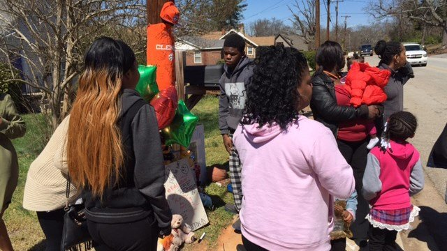 Family and friends gather around memorial for Takevis Rucker. (March 19, 2017 FOX Carolina)